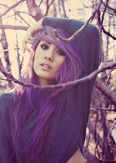 Yeah, so, it's purple, but the girl IS pretty.  And she's chillin' in a sweater in a tree.