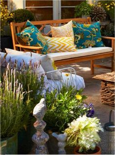 If you live in a space with no lawn, or you simply want to create a more cozy outdoor living environment, add different heights of pots, and stone accessories! .
