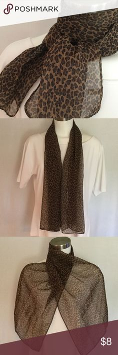 Leopard animal print scarf.  Animal print scarf in leopard look. Tan, brown and black. Great shape except flaw on back middle area of scarf. See picture. See close up picture. 51 1/2 by 13 1/2 inches. Accessories Scarves & Wraps