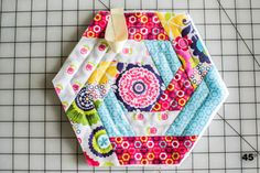 Ya'll know I love to sew potholders. It's the perfect way to use up fabric  and batting scraps. And to practice quilting. Plus when you're done you  have a beautiful and useful item. Sometimes I give them away and (I admit)  a lot of the time I keep them for myself. Having a cute potholder makes  cooking bearable for me. Why only bearable? Because I'd much rather be  sewing. :)