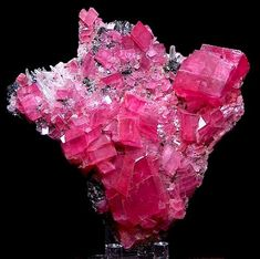 Rhodochrosite: From Steve's Pocket in the Sweet Home Mine in Alma, Colorado. The base matrix is needle Quartz and Tetrahedrite. Measures 8 cm by 8 cm.