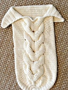 Trecce intrecci Skein and Hook: Free Crochet Pattern: Cabled Baby CocoonIf you're looking for an easy pattern that's almost too cute for words, then the Cuddly Crochet Cable Baby Cocoon is for you. This super snuggly cocoon features the cable stitch Crochet Baby Cocoon Pattern, Newborn Crochet, Baby Blanket Crochet, Crochet Bebe, Cute Crochet, Crochet For Kids, Beautiful Crochet, Baby Bunting, Baby Patterns