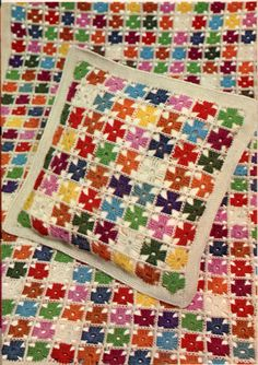 Our most popular pattern! This multicolored afghan blanket and pillow set with a pinwheel design would be so cute in a vintage nursery for boys or