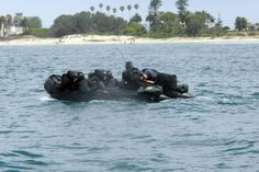 Divers from the Royal New Zealand Navy Mine Counter Measures Team (RNZNMCMT) conduct operations off the coast of Southern California.