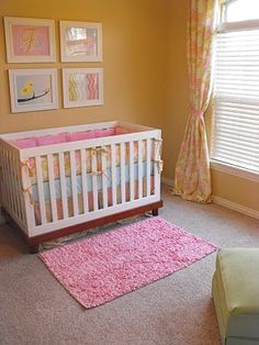 cute girl nursery  - with pictures of baby animals above crib