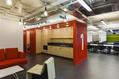 Google Campus in London Featuring Socializing Spaces and Informal Areas.   Kitchen design clean, easy and cheap and also a good division between spaces