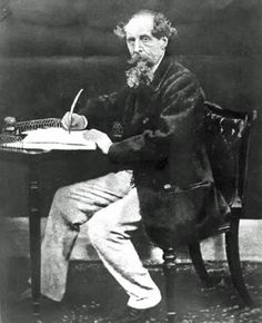 Charles Dickens at his writing desk