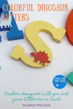 These colorful wood letters are decorated with contrasting wood dinosaur cutouts.p, adding a pop of color and fun to your little boys room wall decor. #boysroom #boynursery #bedroomdecor #gift #woodenletters #name sign #babyshower Boy Nursery Letters, Nursery Name Decor, Wood Nursery, Playroom Decor, Playroom Ideas, Wall Decor, Wood Name Sign, Wood Names, Name Letters