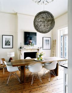 Luella Potter / Mark Tuckey via Inside Out {eclectic white rustic modern dining room} Eames chairs Dining Room Design, Dining Room Chairs, Table And Chairs, Eames Chairs, Eames Dining, Dining Area, Arm Chairs, Kitchen Dining, Ghost Chairs