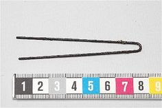 Historical hair pin (medieval to modern). U-shaped bent ten round cross-section. Found in a room in Läcko castle, Sweden.