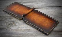 HANDMADE ITALIAN LEATHER WALLETS. CAREFULLY CONSTRUCTED IN ITALY ENTIRELY BY HAND. HAND STITCHED FOR A LONG LIFE. ACTRACTIVE HAND DYED WONDERFUL NUANCES. ITALIAN LEATHER WALLET A leather clip wallet dedicated to all those who appreciate true craftsmanship and want to distinguish himself