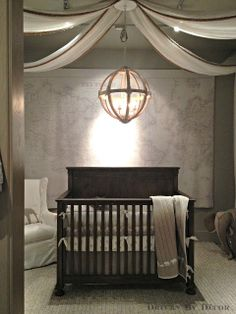 For a  nursery, add warmth and texture with a fabulous ceiling treatment