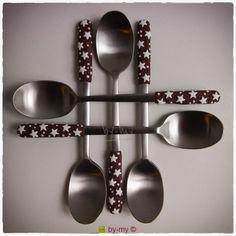 Cucchiani in acciaio con decorazione in pasta sintetica