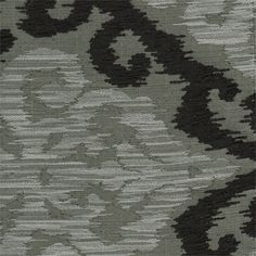This is a beautiful black, silver and grey ikat chenille upholstery fabric. Ideal as decorative pillows or great for upholstering furniture. Fabric suitable for many home decorating applications. Dry cleaning recommended. Compared at $53.95.Width: 60 inV.Repeat: 15 in63% Rayon/37% PolyV219PFFR