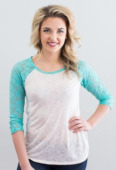 "Lace sleeves detail knit top. 38% Polyester, 62% RayonMade in the USA <3 Model is 5'9"" and size 6 in a Small.     Measurements Length Bust   Small 26.5"" 34""   Medium 27.5 36""   Large 28.5  38"""