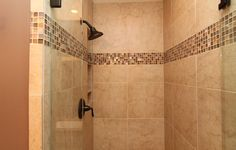 x Here is a beautiful master shower with a frameless shower door.