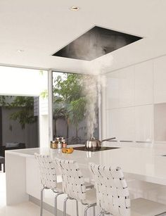 The recessed kitchen vent: Siemens ceiling hood | Corian model kitchen | Remodelista