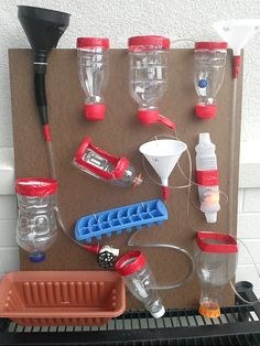 Outdoor Play Water Wall.  Cut bottoms off and Reuse Creamer and Juice Bottles. Use Duct Tape to make edges safe for kids.