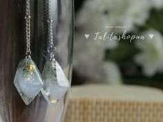 Excited to share the latest addition to my #etsy shop: Delicate long shimmer wedding earrings - Crystal resin earrings - Bridal earrings - Drop earrings - Dainty earrings #jewelry #earrings #girls #earlobe #geometric #otherpolygon #christmas #wedding #artnouveau