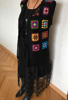 A personal favourite from my Etsy shop https://www.etsy.com/listing/471612548/long-handmade-vest-sleeveless-grany