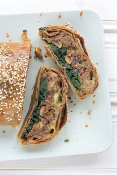 Mushroom Wellington with Spinach Recipe - An elegant, delicious, vegan Christmas dinner! Umami garlic mushrooms, nuts & herbs with lemony spinach layer, all wrapped in vegan spelt/avocado pastry | ramsonsandbramble.com