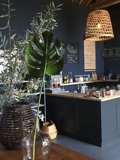 love the way botanical green and natural baskets are contrasted with dark grey at Design Vintage near Chichester. Click through for more interiors inspiration you'l love