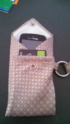 Holder for phone and credit cards made from a tie. 1/23/15