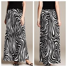 """Banana Republic Zebra Print Patio Skirt Banana Republic Zebra Print Patio Skirt in black and white. Gorgeous and great for any season. Back zip and hook closure. 100% polyester. Laying flat approx 40"""" long, waist approx 14"""" across. Sits at the waist. Size 0. Small snag as seen in 3rd pic. Not noticeable when wearing. Otherwise, excellent condition. Banana Republic Skirts Maxi"""