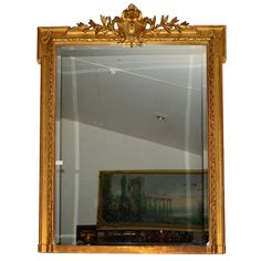 Large mirror #LouisXVI #style in #giltwood. The garland of leaves on the front is in #stucco. 19th century. For sale on #Proantic by Antiquités Leda Decors.