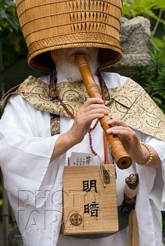Japan - Komuso monk with shakuhachi flute and basket hat
