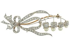 Antique Edwardian Lily of the Valley Diamond and Natural Pearl Flower Brooch in Platinum, ca. 1910