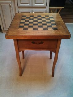 Found a homemade chess board at a thrift store and mounted it to an old sewing machine table.