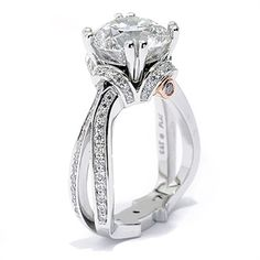 This gorgeous engagement ring won 1st place by Engagement101.com for best vintage inspired engagement ring in 2011. What a timeless design.