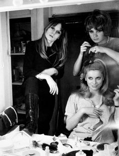 Catherine Deneuve gets her hair done as sister  Françoise Dorléac looks on