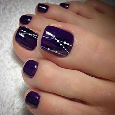 Glamorous dark purple and white toe nail design