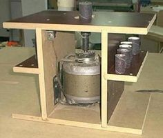 """Spindle Sander by Bricofleur -- Homemade spindle sander constructed from 3/4"""" MDF and powered by a surplus electric motor. The shaft adaptor for the sandpaper drums was sourced commercially. http://www.homemadetools.net/homemade-spindle-sander-2"""