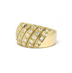 A throwback piece - a 70's disco revival! A delicious domed striped diamond cocktail ring with one carat of grain set round brilliant diamonds in yellow gold.