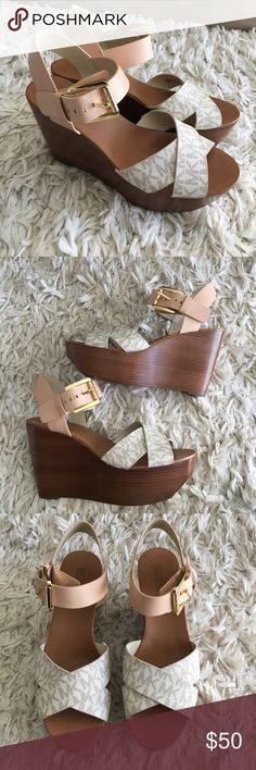 """{NIB} Michael Kors Wedge Heels New in box Michael Kors wedge heels in women's size 6. Leatherman made upper and rubber outsole. 4"""" heel in the back and a little less than 2"""" in the front. MK pattern in the front straps and beige ankle straps. MICHAEL Michael Kors Shoes Wedges"""