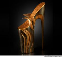 Azzurra  Omar Angel Perez These sculptures are a tribute to all women who endure the torture of wearing stilettos. Their sacrifice does not go unnoticed.This sculpture is handmade from hand picked solid and veneer woods. The height ranges from 17 inches to 24 inches tall. My wife's own heels are first use for templates to emulate a correct insole contour, then the shaping process begins. From a solid piece of wood the actual sole is carved. After the sole has been carved and sanded smooth…
