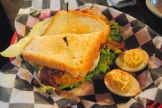 Fried Green Tomato Turkey BLT with a side of deviled eggs at Romie's BBQ.
