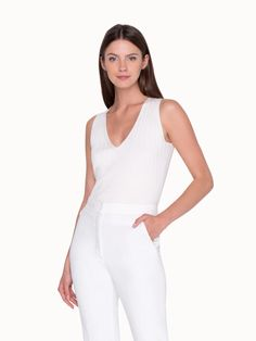 Combine at will. This sleeveless knitted tank is easy to combine for a sleek look. Its stylish v-neck and the comfortable stretch silk will offer unparalleled comfort. Basic Shirts, Cardigan Fashion, Knitted Tank Top, Horse Hair, Sleek Look, Long Jackets, Stretch Pants, Flare Pants, Blazer