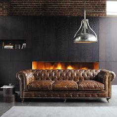 Gorgeous vintage-style Chesterfield, dramatic fireplace, great over-scaled industrial style light.