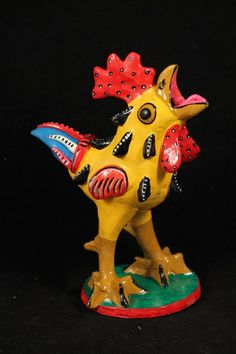 "- This Betus Rooster is 7 3/4"" tall and 6"" in wide. - Gorgeous and bright colors complete this rooster Betus. - These fantasy ""Betus/Nahual"" are visions from the mind of internationally known Juan Jos"