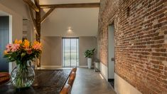 Converting an old farm into a warm industrial farmhouse with big view on an old brick wall, original wooden beams and the beautiful area around the farmhouse. Barn Renovation, House, Small House Renovation, Old Brick Wall, Brick And Stone, Old Bricks, Warm Industrial, Renovations, Old Farm