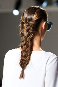Love this Herringbone braid from Suno's Fashion Show NY Fashion Week Spring 2015. It looks fashionable but still do-able. Its essentially a fishtail that has been pulled to widen it. Texture and Hairspray were used to tame fly aways.