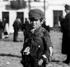A Jewish boy in the Lodz Ghetto, probably in 1941. The Germans cut food deliveries to the ghetto and they were especially interested in eliminating what they referred to as 'non-producers'. Eventually the Lodz children had to be given up to the NazIs who murdered them.