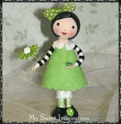 Clothespin doll. Striped sleeves.