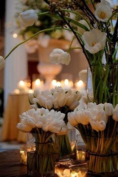 Wedding reception floral arrangement: gorgeous white tulips in a variety of lengths.