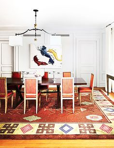 10 Celebrity Dining Rooms You'll Love // The dining room in fashion editor and Project Runway judge Nina Garcia's Upper East Side apartment is, unsurprisingly, as chic as she is. It's hard to decide whether the abstract James Nares painting or the graphic rug steal our attention more—both are to die for.