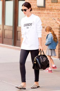 14 June Lily Aldridge wore an oversized Givenchy sweatshirt with black jeans and backless Alexander Wang flats as she ran errands in New York.   - HarpersBAZAAR.co.uk